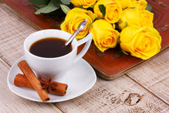Cup of coffee and yellow roses Stock Images