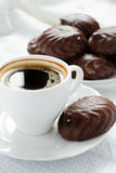 Cup of coffee and zephyr in chocolate Stock Photography