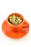 Cup of coins Stock Photos