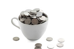 Cup with coins Royalty Free Stock Photo