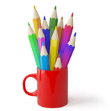 Cup and colored pencils. Stock Photo