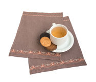 Cup with a compote and biscuits. Cup with a compote and cookies on a napkin embroidered Stock Photography