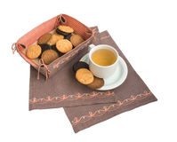 Cup with a compote and biscuits. Cup with a compote and cookies on a napkin embroidered Royalty Free Stock Photography