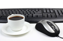 Cup and computer keyboard Royalty Free Stock Photo