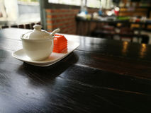 Cup of condiment on a wooden table Stock Photos