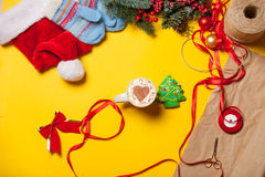 Cup and cookie near gifts Stock Photo