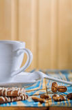 Cup and cookies with coffee beans Stock Images
