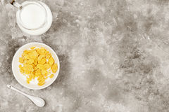 Cup of cornflakes with milk on a light background. Top view, cop Royalty Free Stock Images