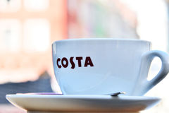 Cup of Costa coffee on cafe patio Stock Photo