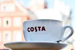 Cup of Costa coffee on cafe patio Royalty Free Stock Photography