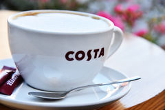 Cup of Costa coffee on cafe patio Stock Image