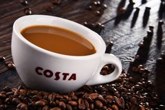 Cup of Costa Coffee coffee and beans Royalty Free Stock Image