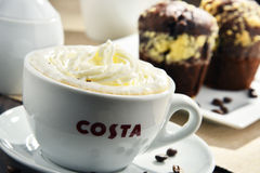 Cup of Costa Coffee coffee and muffins Royalty Free Stock Image