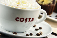 Cup of Costa Coffee coffee and muffins Royalty Free Stock Photo