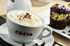 Cup of Costa Coffee coffee and muffins Stock Photo