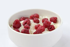 Cup with cream cheese and raspberries Royalty Free Stock Photography