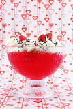 Cup with cream and strawberries Royalty Free Stock Image