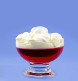 Cup with cream and strawberry jelly Stock Photos