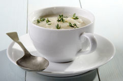 Cup with creamy cauliflower soup Royalty Free Stock Image