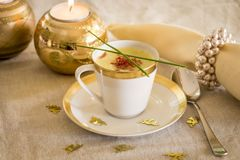 Cup of creamy potato soup and serrano ham chips for Christmas dinner Stock Image