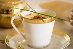 Cup of creamy potato soup and serrano ham chips for Christmas dinner Stock Photos