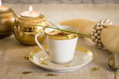 Cup of creamy potato soup and serrano ham chips for Christmas dinner Royalty Free Stock Images