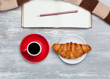 Cup, croissant and book Royalty Free Stock Image
