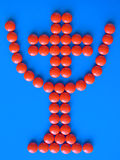 Cup with cross inside. Of orange pills vector illustration