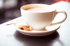 Cup of cuppucino. Cup of coffee with cake on the table Royalty Free Stock Images