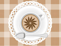 Cup of cupuccino. A Cup of coffee cappuccino with a pattern on the tablecloth and napkin Royalty Free Stock Image