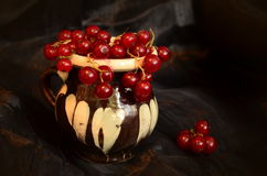The cup with currants Stock Photo
