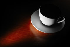 Cup in dark Royalty Free Stock Photography