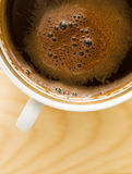Cup of dark brown coffee Royalty Free Stock Image