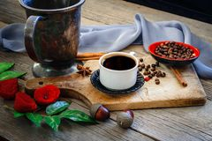 Dark coffee and brown coffee beans Royalty Free Stock Image