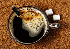 A cup of dark instant coffee with sugar Stock Photo