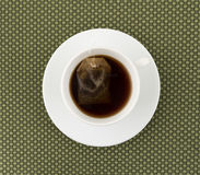 Cup of decaffeinated black tea with tea bag Stock Photography