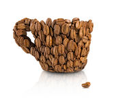 A cup decorated with coffee beans on a white background. Isolated image of a cup decorated with coffee beans on a white background Stock Photos
