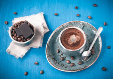 Cup of delicious coffee with chocolate and cream Royalty Free Stock Photography