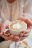 Cup of delicious coffee with a heart Royalty Free Stock Photo