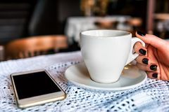 Cup of coffee and smartphone Royalty Free Stock Photo