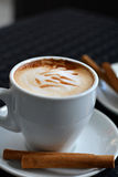 Cup of delicious foamy cappuccino on the black background Stock Images