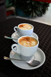Cup of delicious foamy cappuccino on the black background Royalty Free Stock Image