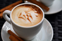 Cup of delicious foamy cappuccino on the black background Stock Image