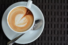 Cup of delicious foamy cappuccino on the black background Stock Photo