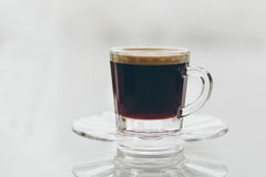Cup of delicious frothy black espresso coffee Stock Photos
