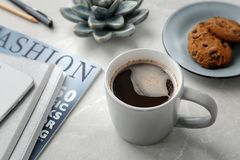Cup of delicious hot coffee. On table Stock Photography