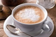 Cafe Latte. A cup of delicious hot and foamy cafe latte stock image
