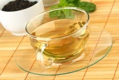 Cup des grünen Tees Stockbilder