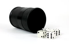 Cup and dice Stock Photos