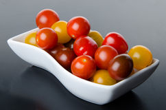 Cup of different varieties of cherry tomatoes Royalty Free Stock Photo